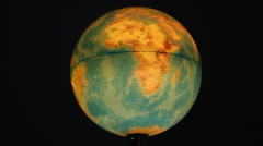 Planet earth globe spinning and slowing to stop over South America Stock Footage