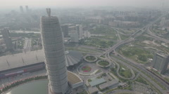 Flying towards a massive futuristic pagoda building, fusion architecture China Stock Footage