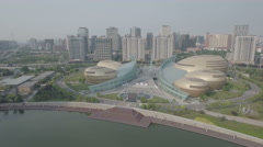 High angle slider shot of egg shaped convention center building China Stock Footage