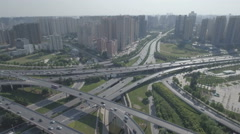 Flying over busy intersection, residential apartment towers in Chinese suburbs Stock Footage