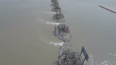 Flying over the ruins of an old bridge in the Yellow River in China Stock Footage