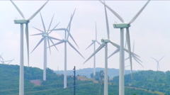 A coal fired power plant is seen near a wind farm. Stock Footage