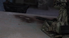 Military equipment on the floor. Camouflage vest with the cartridges in the Stock Footage