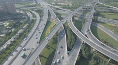 Aerial drone shot flying over busy highway in China Stock Footage