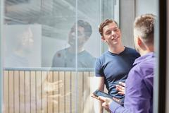 Two male designers talking in design studio Stock Photos