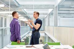 Two male designers meeting in design studio Stock Photos