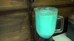 Process of blending milk coctail flavor bubble gum or mint by blender Stock Footage