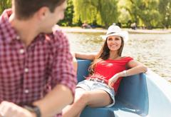 Happy young couple rowing on boating lake in Regents Park, London, UK Stock Photos