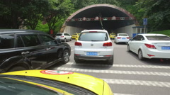 Traffic jam before tunnel, rush hour in Chongqing city, transportation China Stock Footage