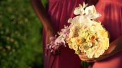 Girlfriend with a bouquet of orchids and roses in his hands. Close-up Stock Footage