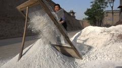 Chinese construction worker filter rocks and cement, super slow motion Stock Footage