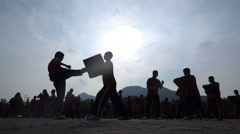Slow motion silhouettes martial arts students kung fu school China Stock Footage
