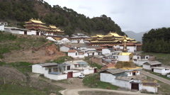 View of a large Buddhist monastery in the mountains around Langmusi Stock Footage