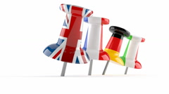 Four thumbtacks with flags Stock Footage