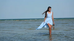 Beautiful attractive girl came to the beach and went into the water Stock Footage