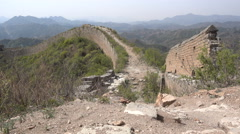 View of a crumbling unrestored section of the ancient Great Wall of China Stock Footage