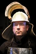 Portrait of mature male foundry worker wearing welding mask in bronze foundry Stock Photos
