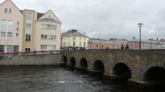 IRELAND JULY 2016 Men Fishing From Stone Bridge into River Galway Stock Footage