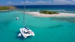 Aerial video of a Catamaran at Sandy Spit, British Virgin Islands Stock Footage
