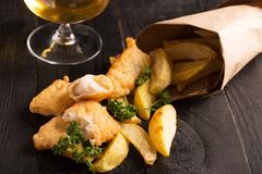 Traditional British fish and chips with parsley Stock Photos