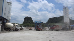 View of industrial trucks loading cement at a factory in China Stock Footage