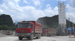 Truck loading cement for construction sector, heavy industry China Stock Footage