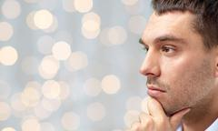 Close up of male face over lights background Stock Photos
