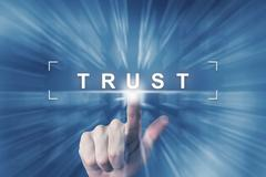 Hand clicking on trust button Stock Photos