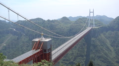 China infrastructure, long suspension bridge over mountain valley Hunan Stock Footage