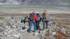 Hikers packpackers walking in high mountain area slow motion close view Stock Footage