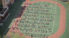 Chinese school children assemble at the playground Stock Footage