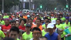 Massive crowds take part in annual Shanghai marathon run, sports in China Stock Footage