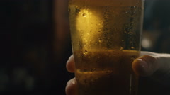 Beer is poured into a glass Stock Footage