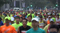 Huge crowds run through the streets of Shanghai during marathon event Stock Footage