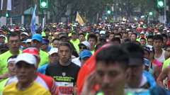 Tired focused faces of people taking part in Shanghai marathon, sports China Stock Footage