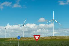 Wind turbines on top of dyke, Rotterdam, South Holland, Netherlands Stock Photos