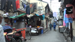 People walk through the old town in Shanghai, China Stock Footage