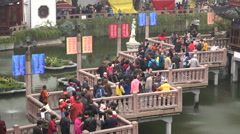 Crowds of tourists visit the Yuyuan Gardens, a popular attraction in Shanghai Stock Footage