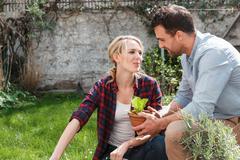 Couple in garden tending to plants Stock Photos
