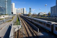 View on railroad, train and financial district in Vienna Stock Photos