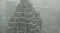 Detail of the Jin Mao tower, a Shanghai icon, on a grey day Stock Footage