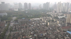 New flats loom over an old neglected neighborhood in Shanghai, China Stock Footage