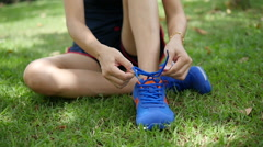 Asian woman ties shoes lace. Stock Footage