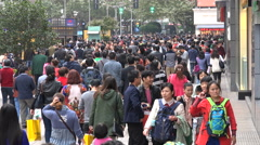 People walk through busy shopping street in Shanghai, China Stock Footage