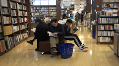 Chinese people read books in popular bookstore Shanghai Stock Footage