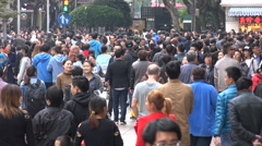 Busy shopping street with crowds of people in Shanghai, China Stock Footage