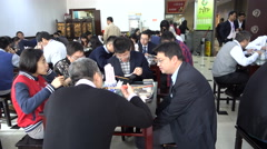 Busy canteen of an office tower, people on a lunch break in Shanghai, China Stock Footage