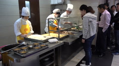 Buffet lunch inside a corporate office tower in Shanghai, China Stock Footage
