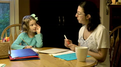Mother and daughter doing homeschool together Stock Footage