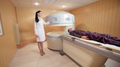 Mri assistant performing scanning Stock Footage